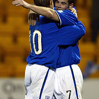 St Johnstone v Dunfermline..CIS Cup..28.10.03<br />Peter MacDonald is hugged by Simon Donnelly after scoring St Johnstones third goal<br /><br />Picture by Graeme Hart.<br />Copyright Perthshire Picture Agency<br />Tel: 01738 623350  Mobile: 07990 594431