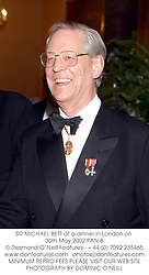 SIR MICHAEL BETT at a dinner in London on 30th May 2002.	PAN 8