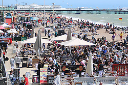© Licensed to London News Pictures. 06/06/2015. Brighton, UK. People are sunbathing on Brighton Beach. Thousands of people are visiting Brighton and the South Coast with temperatures being the hottest of the year so far. today June 6th 2015. Photo credit : Hugo Michiels/LNP