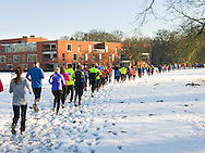 Nederland, Vught, 20141231.<br /> Oliebollenveldloop in Vught op oudejaarsmiddag op Reinier van Arkel<br /> Loopschool Wim Akkermans