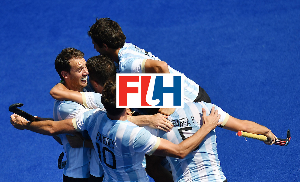 Argentina's players celebrate at the end of the men's quarterfinal field hockey Spain vs Argentina match of the Rio 2016 Olympics Games at the Olympic Hockey Centre in Rio de Janeiro on August 14, 2016. / AFP / MANAN VATSYAYANA        (Photo credit should read MANAN VATSYAYANA/AFP/Getty Images)