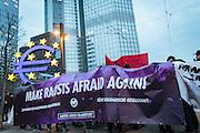 Frankfurt | 25 February 2017<br /> <br /> Am Samstag (25.02.2017) nahmen etwa 1000 Menschen in Frankfurt am Main an einer linksradikalen Demonstration unter dem Motto &quot;Make Racists Afraid Again&quot; Teil. Die Demo begann am S&uuml;dbahnhof in Frankfurt-Sachsenhausen und endete am Willy-Brandt-Platz. Organisiert wurde der Aufmarsch von dem B&uuml;ndnis &quot;Antifa United Frankfurt&quot;.<br /> Hier: Die Demo ist auf dem Willy-Brandt-Platz angekommen, im Hintergrund die gro&szlig;e Euro-Skulptur und das ehemaile Hochhaus der EZB (ECB).<br /> <br /> photo &copy; peter-juelich.com