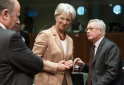 Christine Lagarde, France's finance minister, center, shares a laugh with Giulio Tremonti, Italy's finance minister, right, as they arrive for the emergency meeting of European Union finance ministers in Brussels, Belgium, on Sunday, May 9, 2010.  European Union finance ministers meet today to hammer out the details of an emergency fund to prevent a sovereign debt crisis from shattering confidence in the 11-year-old euro. (Photo © Jock Fistick)