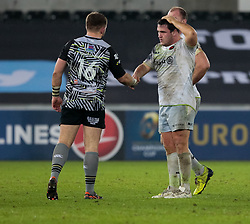 A dejected Saracens' Jamie George shakes hands with Ospreys' Scott Otten<br /> <br /> Photographer Simon King/Replay Images<br /> <br /> European Rugby Champions Cup Round 5 - Ospreys v Saracens - Saturday 13th January 2018 - Liberty Stadium - Swansea<br /> <br /> World Copyright © Replay Images . All rights reserved. info@replayimages.co.uk - http://replayimages.co.uk
