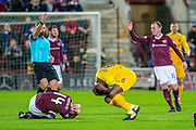 Marvin Bartley (#6) of Livingston FC and Steven Naismith (#14) of Heart of Midlothian FC clash heads during the Ladbrokes Scottish Premiership match between Heart of Midlothian FC and Livingston FC at Tynecastle Park, Edinburgh, Scotland on 4 December 2019.