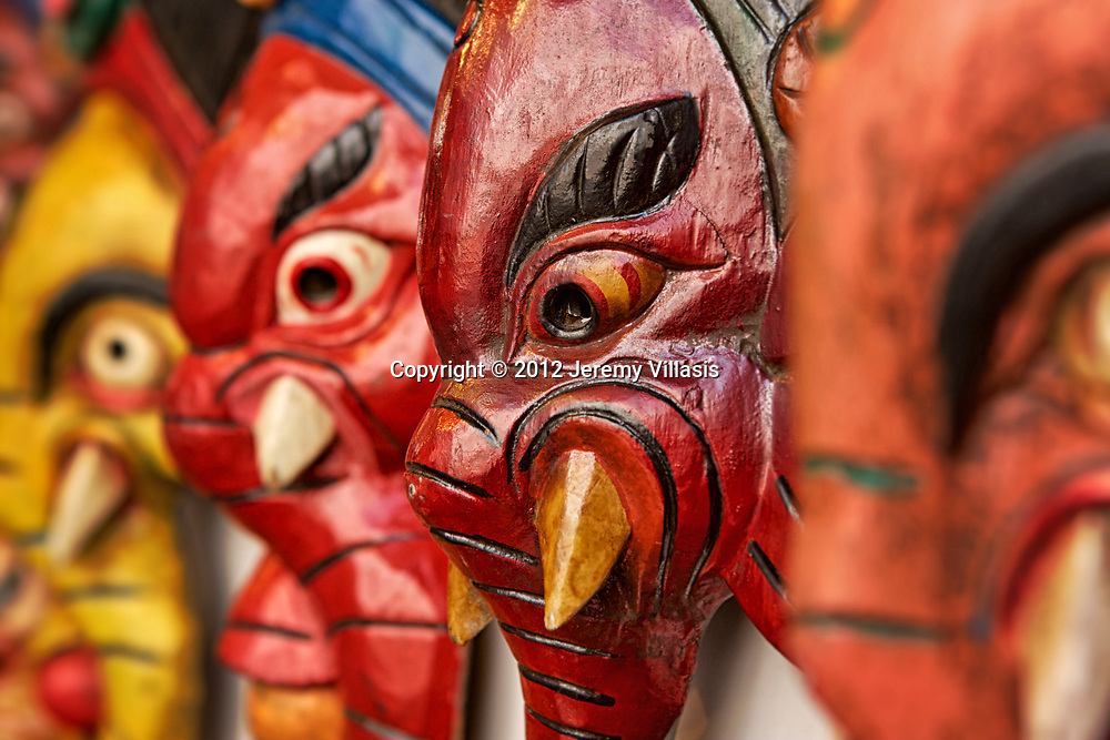 Wooden elephant masks on display at a souvenir stall at Chhatta Chowk, a bazaar inside the Red Fort in New Delhi, India.