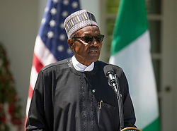 United States President Donald J. Trump and President Muhammadu Buhari of Nigeria depart the Oval Office to conduct a joint press conference with in the Rose Garden of the White House in Washington, DC on Monday, April 30, 2018. Credit: Ron Sachs / CNP. 30 Apr 2018 Pictured: President Muhammadu Buhari of Nigeria makes remarks as he conducts a joint press conference with United States President Donald J. Trump in the Rose Garden of the White House in Washington, DC on Monday, April 30, 2018. Credit: Ron Sachs / CNP. Photo credit: Ron Sachs - CNP / MEGA TheMegaAgency.com +1 888 505 6342