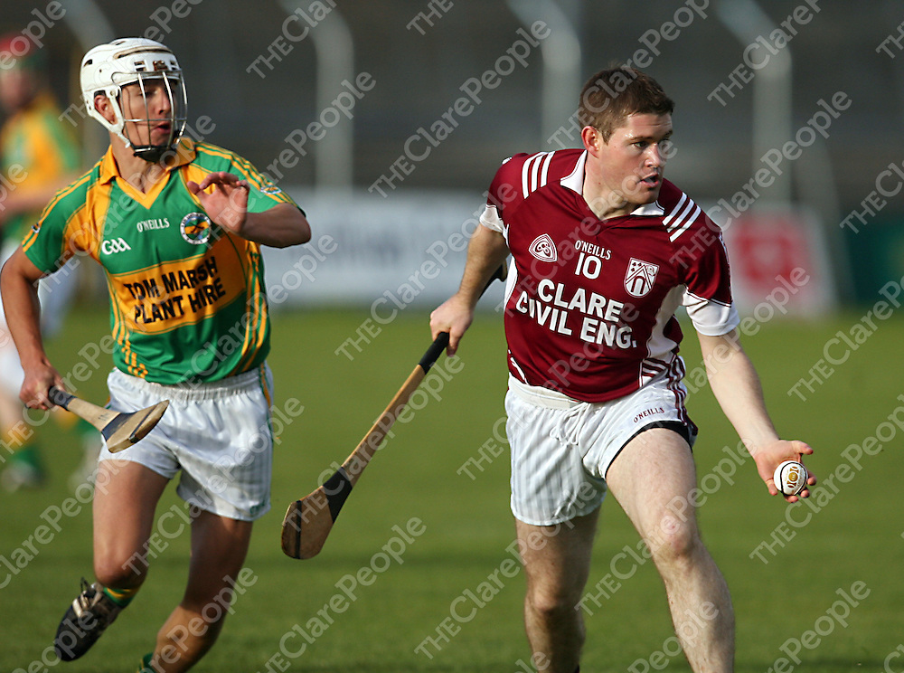 Doora/Barefield's Damien Kennedy gets the ball away from Broadford's Aidan O' Brien during their game in Cusack Park on Friday evening.<br /> Photograph by Yvonne Vaughan