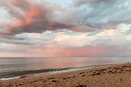 A pink rainbow appears off of Head of the Meadow Beach in the moments before sunset.