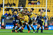 Waisake Naholo tackled during the super rugby union  game between Hurricanes  and Highlanders, played at Westpac Stadium, Wellington, New Zealand on 24 March 2018.  Hurricanes won 29-12.