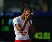 05/23/2009 -   Lincoln's Tiara Pittman (626) weeps in surprise after she wins the 6A Girl's 300 Meter Hurdles. The 2009 OSAA/U.S. Bank/Les Schwab Tires 6A-5A-4A Track and Field State Championships were run at Hayward Field in Eugene, Oregon.....KEYWORDS:  City, Portland, sports, Oregon, high school, OSAA, boys, girls, PIL, run, University, team