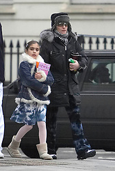 Exclusive photos.<br /> Guy Ritchie (not in frame), Madonna and Lola coming from the Kabbalah Centre, London. Despite the heavy coat, baggy pants, glasses and change of hats, Madonna was still recognisable.2nd May, 2005,<br /> London, United Kingdom<br /> Picture by Mike Webster / i-Images