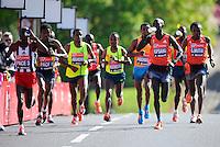 Wilson Kipsang has a drink en route to his win in the Men's Elite race<br /> The Virgin Money London Marathon 2014<br /> 13 April 2014<br /> Photo: Javier Garcia/Virgin Money London Marathon<br /> media@london-marathon.co.uk