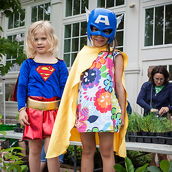 Street photography: Two young girls walking through the Worthington Farmer's Market posed for a picture Saturday June 21, 2014. (Christina Paolucci, photographer).
