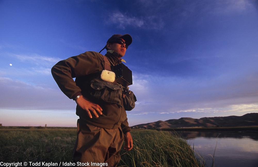 Idaho, near Sun Valley, Picabo, Silver Creek Preserve, Fly fisherman, Asian man lookin, summer