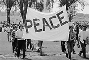 "24 May 1970, Washington, DC, USA --- Anti-Vietnam War protesters in Washington DC hold a sign that reads ""Peace"" during a demonstration for the students killed at Kent State. --- Image by © Leif Skoogfors"