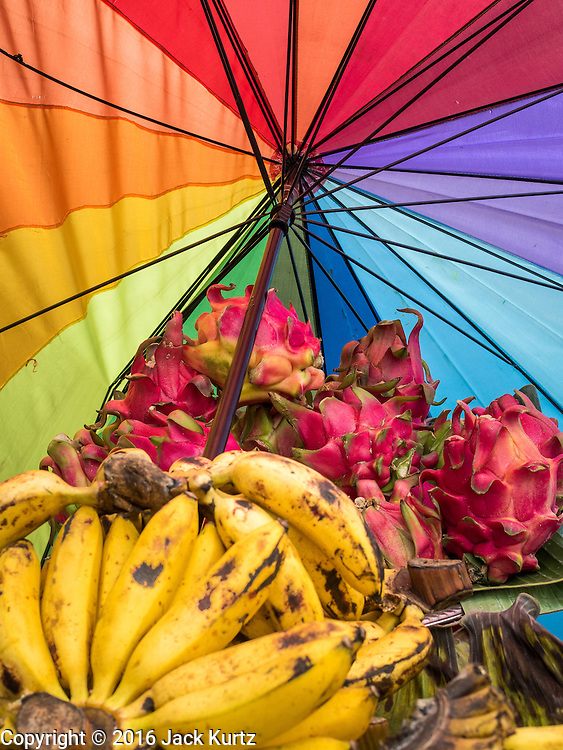 17 JULY 2016 - UBUD, BALI, INDONESIA: Bananas and dragonfruit for sale on the side of the road in Ubud, Bali.      PHOTO BY JACK KURTZ