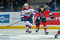 KELOWNA, BC - NOVEMBER 26: Michael Farren #16 of the Kelowna Rockets is checked by Riley Sawchuk #13 of the Edmonton Oil Kings during first period at Prospera Place on November 26, 2019 in Kelowna, Canada. (Photo by Marissa Baecker/Shoot the Breeze)