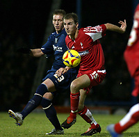 Photo: Chris Ratcliffe.<br /> Southend United v Swindon Town. Coca Cola League 1. 27/01/2006.<br /> Freddy Eastwood (L) of Southend and Andy Nicholas of windon tussle for the ball