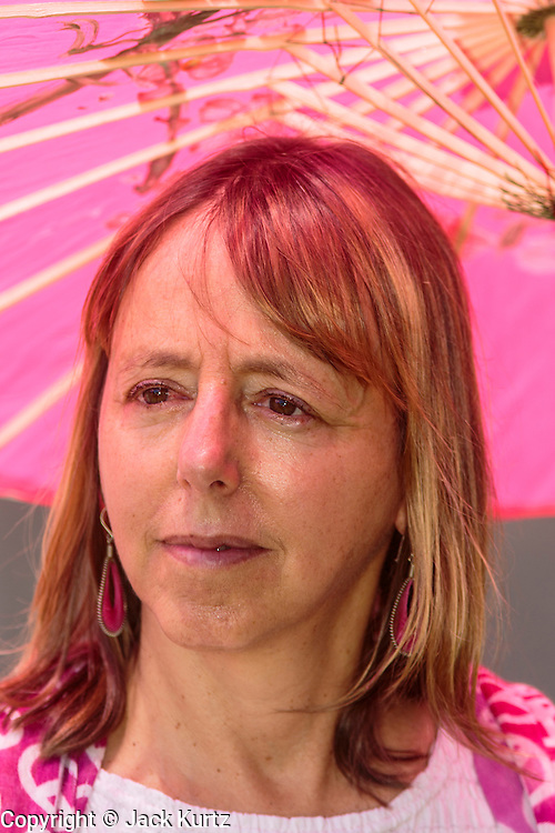 "31 JULY 2012 - PHOENIX, AZ:  MEDEA BENJAMIN waits to speak at a press conference at the Arizona State Capitol Tuesday. Medea is a political activist, best known for co-founding Code Pink and, along with her husband, activist and author Kevin Danaher, the fair trade advocacy group Global Exchange. She was also a Green Party candidate in 2000 for the United States Senate. She appeared in Phoenix to promote her new book, ""Drone Warfare: Killing by Remote Control."" She, and other members of Code Pink, presented a letter to Arizona Gov. Jan Brewer protesting Brewer's request to use the state's airspace to train drone pilots.  PHOTO BY JACK KURTZ"
