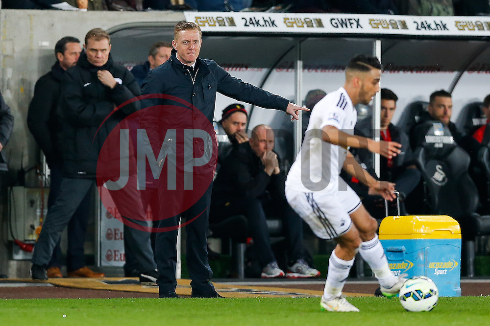 Swansea City Head Coach Garry Monk points - Photo mandatory by-line: Rogan Thomson/JMP - 07966 386802 - 16/03/2015 - SPORT - FOOTBALL - Swansea, Wales — Liberty Stadium - Swansea City v Liverpool - Barclays Premier League.