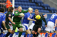 Photo: Pete Lorence.<br />Leicester City v Plymouth Argyle. Coca Cola Championship. 11/11/2006.<br />Conrad Logan dives for the ball during a goalmouth scuffle.