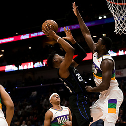 Feb 12, 2019; New Orleans, LA, USA; Orlando Magic forward Wesley Iwundu (25) shoots over New Orleans Pelicans center Julius Randle (30) during the first quarter at the Smoothie King Center. Mandatory Credit: Derick E. Hingle-USA TODAY Sports