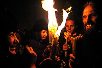 A Christian Orthodox belivers  during the Holy Fire ceremony in the Church of the Holy Sepulcher in Jerusalem April 30, 2005. The Holy Fire ceremony is part of Orthodox Easter and the flame symbolises the resurrection of Christ.
