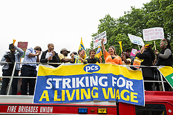 London, UK. 19 June, 2019. Outsourced catering, security, postal, porter and cleaning staff belonging to the Public & Commercial Services Union (PCS) and working at the Department for Business, Energy and Industrial Strategy (BEIS) via contractors ISS World and Aramark attend a rally outside Parliament on the third day of continuing industrial action for the London Living Wage, terms and conditions comparable to the civil servants they work alongside and an end to outsourcing.