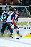 KELOWNA, CANADA - AUGUST 30: Kamloops Blazers prospect #2 Michael Fora stops on the ice in front of linesman Kevin Crowell on August 30, 2014 during pre-season at Prospera Place in Kelowna, British Columbia, Canada.   (Photo by Marissa Baecker/Shoot the Breeze)  *** Local Caption *** Kevin Crowell; Michael Fora;