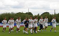Photo: Paul Thomas.<br /> England training at Carrington. 30/08/2006. <br /> <br /> <br /> John Terry (C) and England warm up.