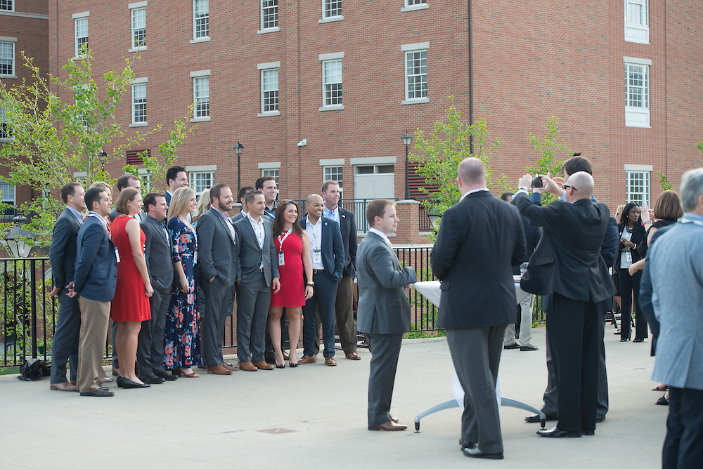 A group of people have their photo taken at the Charles R. Higgins Distinguished Alumnus Award Banquet outside of Nelson Commons. © Ohio University/ Photo by Kaitlin Owens