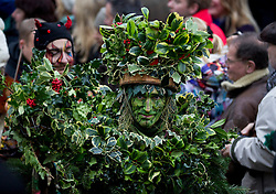 © Licensed to London News Pictures. 06/01/2013. London, UK. A member of the 'Bankside Mummers' dressed as the 'Holly Man' is seen amongst members of the public during the annual 'Twelfth Night' Celebration in London today (06/01/13). The tradition, a pagan celebration of the new year and the end if Christmas, takes place every year at Bankside outside the Globe Theatre and sees the actors of the Bankside Mummers perform for the public. Photo credit: Matt Cetti-Roberts/LNP