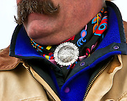 The silver concho and colorful wildrag are a favorite addornment for the Buckaroo.