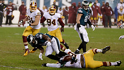 Eagles running back DeMarco Murray fumbles the ball, which is then picked up by the Redskins to be turned into a touchdown.<br /> <br /> Check elsewhere on this site for all images of this shoot. Selected images are published as part of photo essay on WHYY's NewsWorks.org. - http://www.newsworks.org/index.php/local/item/89516-young-champions-celebrated-at-eagles-game-photos<br /> <br /> (&copy;2015, All Rights reserved - Bastiaan Slabbers/BasSlabbers.com)
