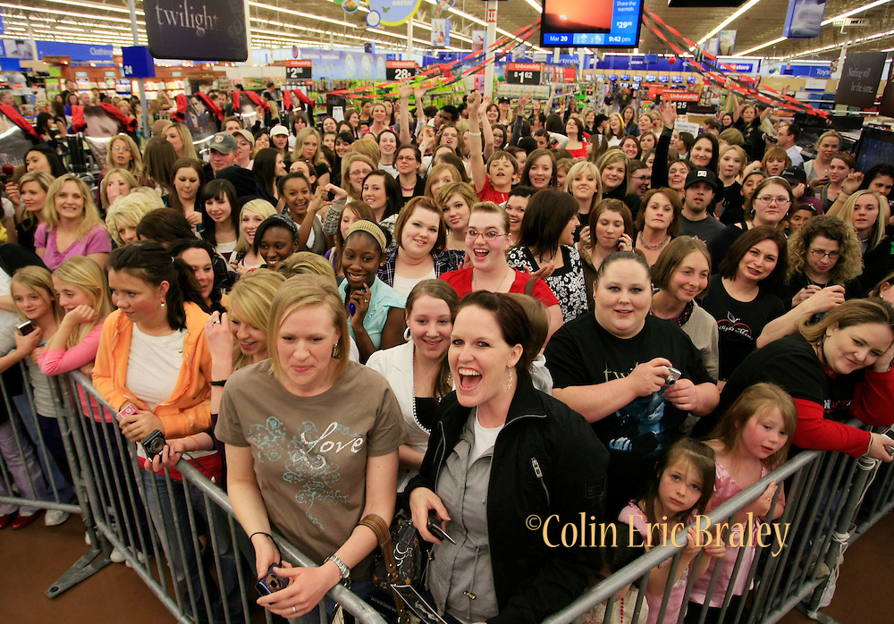 Fans wait for the arrival of Twilight star Rachelle Lefevre, who plays the character Victoria, at the Walmart store in Riverton, Utah during the midnight DVD movie release event March 20, 2009. (AP Photo/Colin Braley)