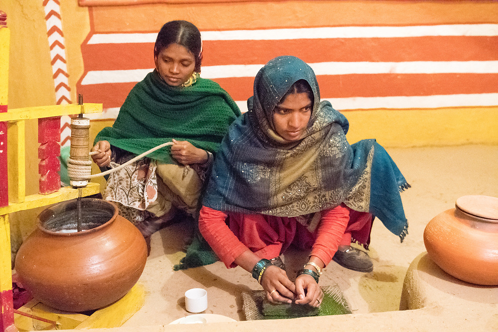 Indian women making pottery