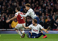 Football - 2018 / 2019 Premier League - Arsenal vs. Tottenham Hotspur<br /> <br /> Harry Kane (Tottenham FC) sits on the floor and appeals to the referee at The Emirates.<br /> <br /> COLORSPORT/DANIEL BEARHAM
