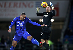 Cardiff City's Kenneth Zohore (left) and Preston North End goalkeeper Chris Maxwell battle for the ball during the Sky Bet Championship match at The Den, London.