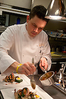 .the kitchen of Cafe Boulud, NYC...Chef Gavin Kaysen, saucing Quail
