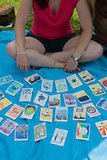 Young fortune teller with astrological cards on a blanket