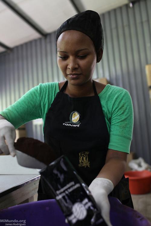 Yanna Obregón Aragón packs ground coffee. COOCAFE, Tilarán, Guanacaste, Costa Rica. August 22, 2012.