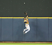 Milwaukee Brewers center fielder Carlos Gomez makes a leap to catch the ball ending the game. (AP Photo/Andy Manis)