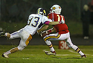Marion's Quinn Cannoy (11) can't pull in a pass as he is hit by Central DeWitt's Hunter Wagener (33) during their second round playoff football game at Thomas Park Field in Marion on Monday, October 29, 2012.