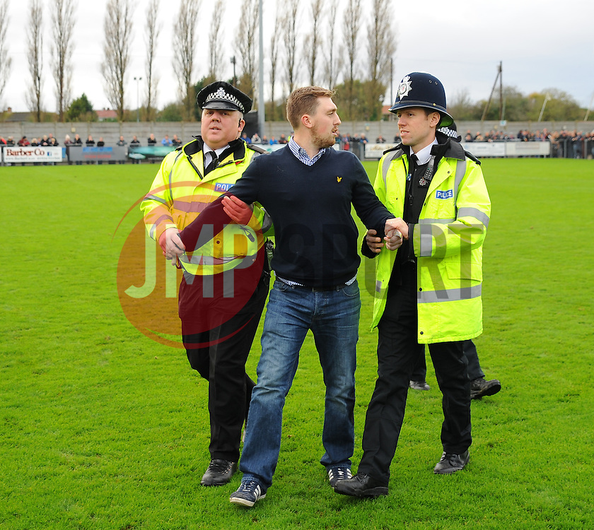 Doncaster Rovers' Fan gets arrested - Photo mandatory by-line: Nizaam Jones - Mobile: 07583 387221 - 08/11/2014 - SPORT - Football - Weston-super-Mare - Woodspring Stadium - WSM v Doncaster - Sport - Round One
