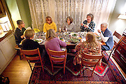 The members of the Books for Cooks Bookclub begin to eat their specially-prepared meals before their meeting, Wednesday, November 19, 2014.<br /> <br /> Ben Brewer for the Wisconsin State Journal