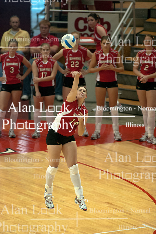09 OCT 2005 Redbirds Laura Doornbos unleashes a powerful serve. The Illinois State University Redbirds hosted arch rival Bradley University Braves.  The Redbirds soared over the Braves, taking the match in 4 games, losing only game number 2.  Action included play by Braves Star Lindsey Stalzer who is ranked no. 7 in the nation in kills per game.  The first defeat of the conference season for the Braves took place at Redbird Arena on Illinois State's campus in Normal IL.