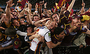 Picture taken at Telstra Stadium Homebush during the rugby league Grand Final between The Melbourne Storm and the Brisbane Broncos. <br /> Picture shows the winning captain from the Broncos Darren Lockyer being mobbed by fans during their celebration lap at the end of the game.