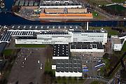 Nederland, Zuid-Holland, Rotterdam, 20-03-2009; Bedrijventerrein Spaanse Polder, met Delfhavensche Schie. In de voorgrond de voormalige van Nellefabriek voor tabak, koffie en thee. De voormalige fabriek is een Rijksmonument en een voorbeeld van 'Het Nieuwe Bouwen'. Het gebouw van architect Van der Vlugt is nu in gebruik als 'Ontwerpfabriek' en wordt gebruikt voor kantoren, evenementen en dergelijke. Aan de andere kant van het water Penitentiaire Inrichting 'De Schie' van architect Carel Weeber. Zowel Huis van Bewaring als gevangenis. Air view on the Business park, with the old Van Nelle factory,  a industrial monument. The orange building is prison De Schie ( top) has been built by architect Carel Weeber. .Swart collectie, luchtfoto (toeslag); Swart Collection, aerial photo (additional fee required).foto Siebe Swart / photo Siebe Swart