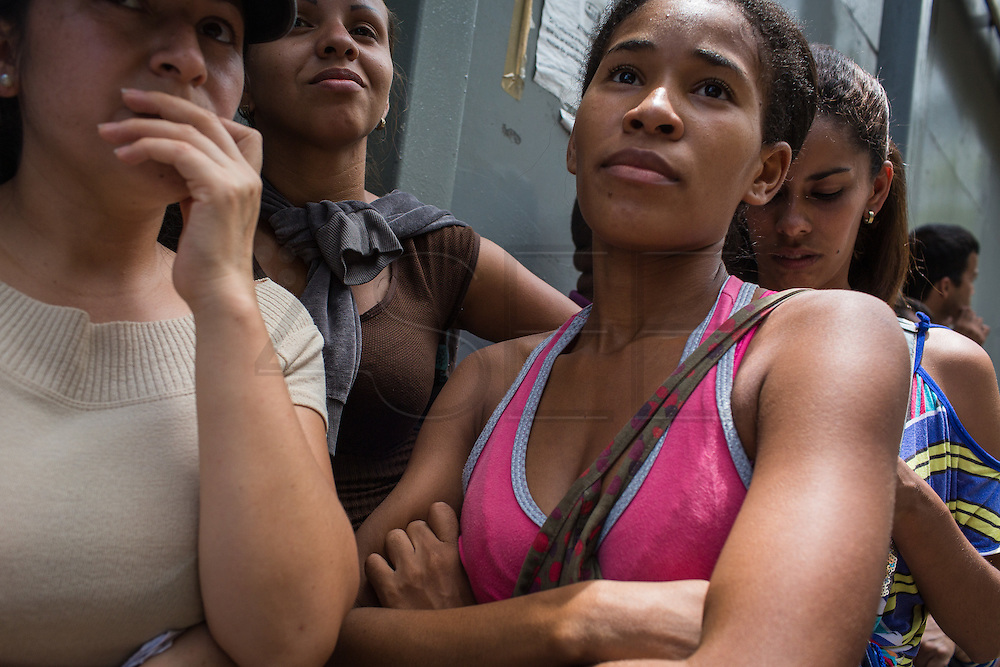 2016/05/26 - Caracas, Venezuela: Yaneth Goméz, 22, waits in the queue even after the subsidized butter runned out, in case some other products hits the shells of the supermarket in La Urbina neighbourhood, Caracas. She has been queuing since 5am in order to buy butter. (Eduardo Leal)